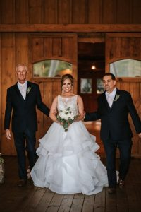 Who should walk you down the aisle? Qwen chose her dad and step dad to walk her down the aisle.