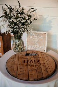 A wooden platter for wedding guests to sign.