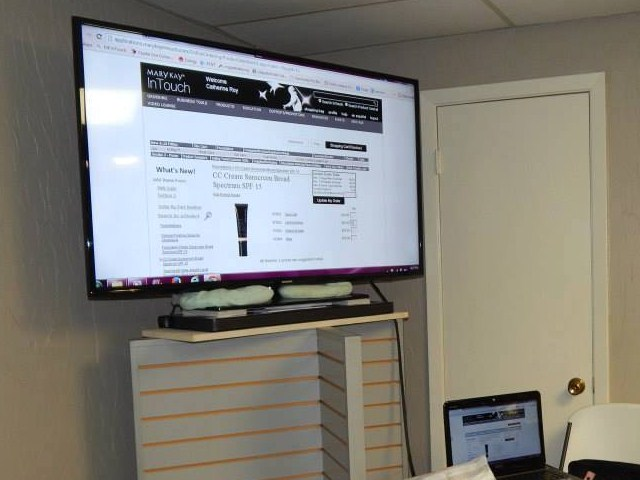 A smart tv setup for a business event at The Gathering Place venue located near Lafayette, Louisiana.
