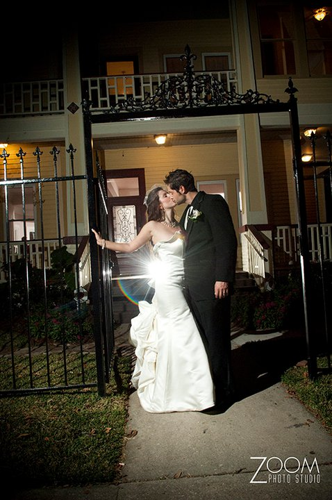 A bride and groom photo taken in fron of Esprit de Coeur after a wedding reception in Lafayette, Louisiana.