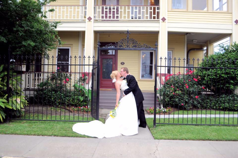 The bride and groom in front of Esprit de Coeur venue near lafayette louisiana