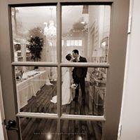 A beautiful bride and groom photo taken through a window after wedding at Esprit de Coeur near Lafayette, Louisiana.