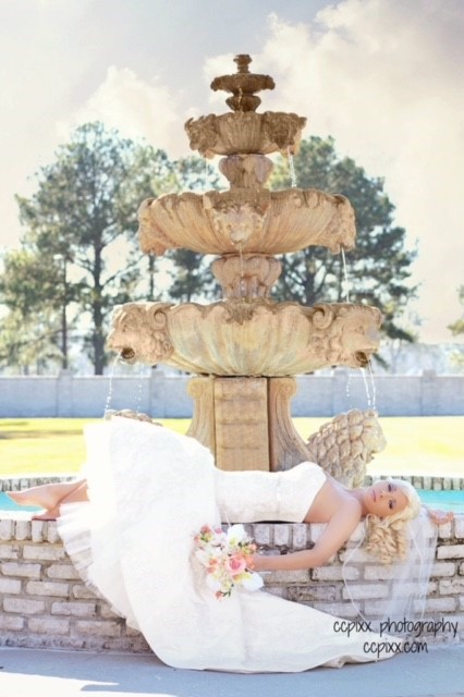 Awesome photo of a bride posed outdoor of The Manor a beautiful wedding venue located in New Iberia, Louisiana.