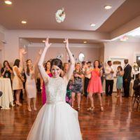 A bride throwing her wedding bouquet at the wedding venue, Esprit de Coeur, located near Lafayette, Louisiana.