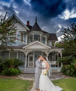 Beautiful Bride and groom in the front of wedding venue Sunny Meade located near Lafayette, Louisiana.