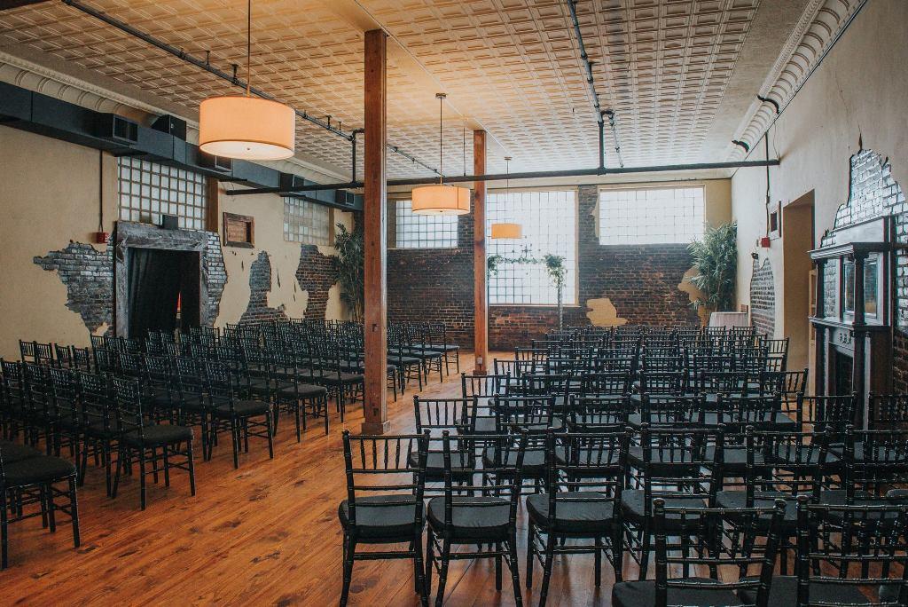 An indoor wedding setup at The Crossing of Mervin Kahn, a wedding venue near Lafayette, Louisiana in Rayne.