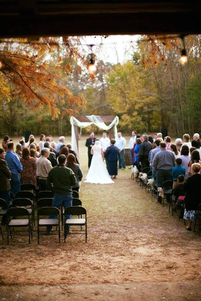 A beautiful outdoor wedding setup with the bride and groom and family at Cypress Grove Wedding Venue.