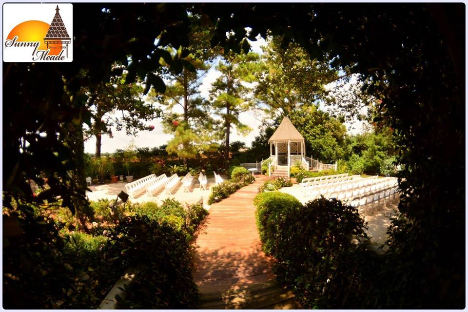 An amazing outdoor wedding setup with a gazebo at the wedding venue, Sunny Meade, located in Lafayette, Louisiana.
