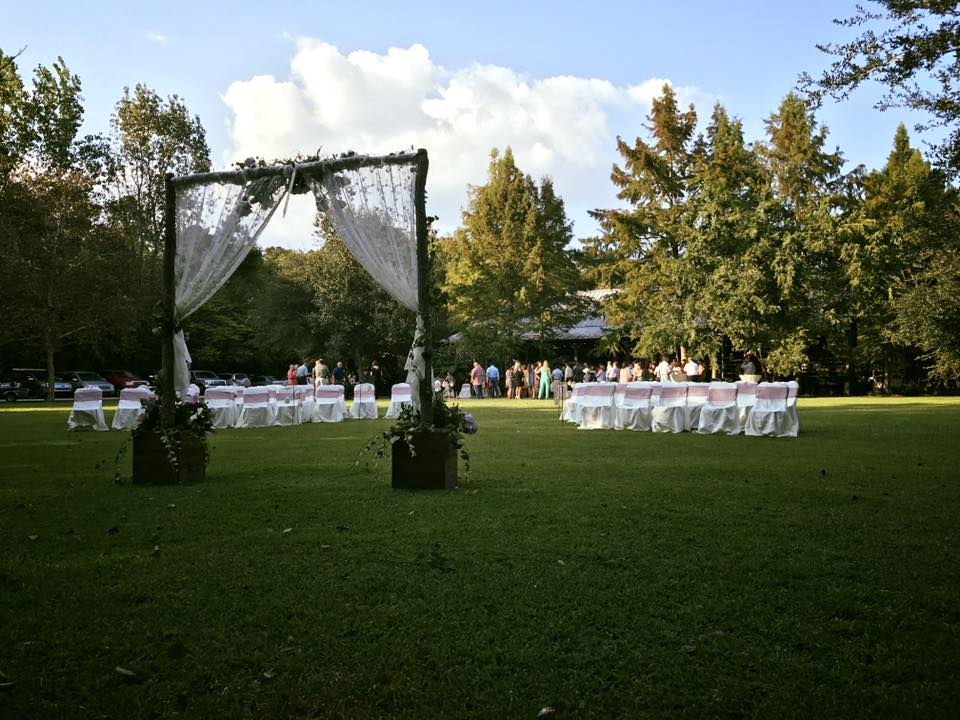 An outdoor wedding setup with chairs and guests at the beautiful Cypress Grove Wedding Venue in near Lafayette, Louisiana in Eunice.