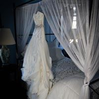 A wedding dress hanging in the dressing suite for a wedding at Esprit de Coeur near Lafayette Louisiana.
