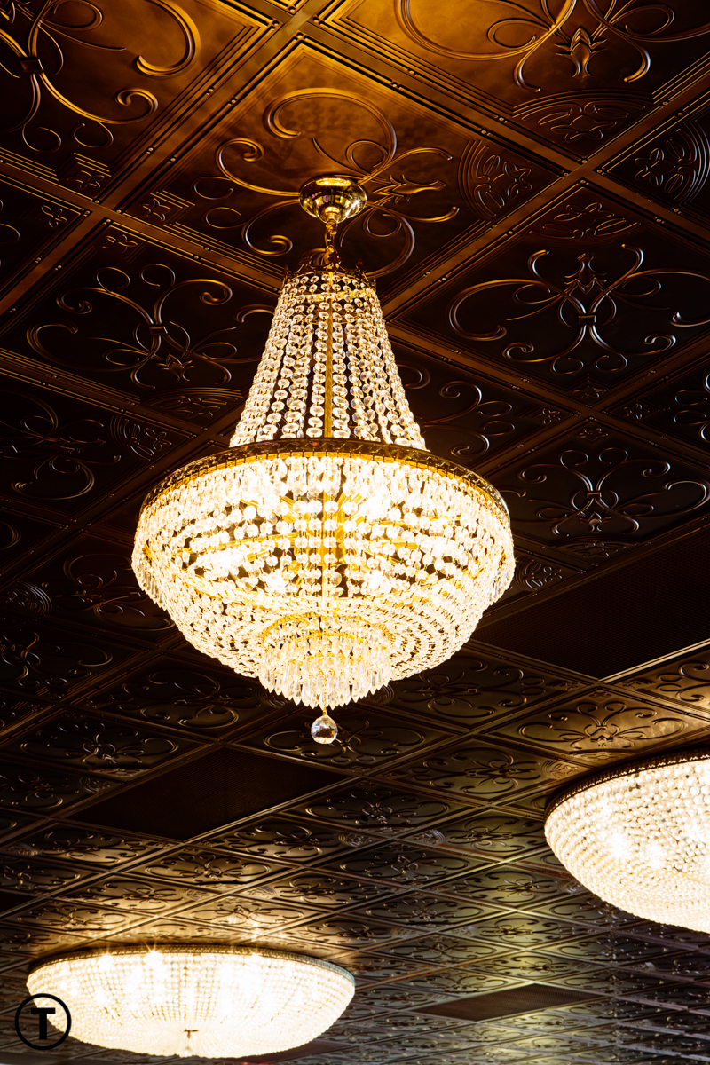Amazing chandelier hanging from the ceiling at the wedding venue Reeves Uptown Catering in lake charles louisiana.