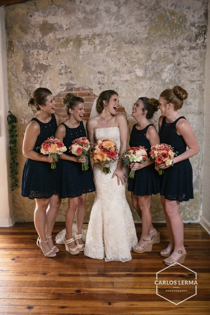 A beautiful bride and her bridesmaids in the wedding venue, Maison de Tours, located near Lafayette, LA.