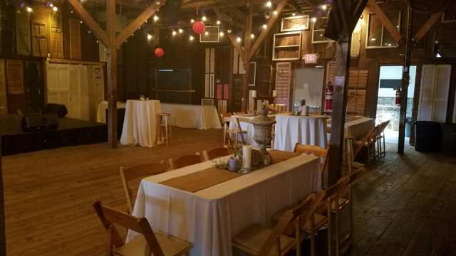 A wedding venue located in Lafayette, Louisiana, Feed n Seed, a rustic wedding reception tables setup.