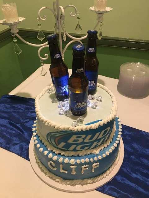 A wedding grooms cake with editable bud lite bottles on top by wedding cake baker, Miss Jo Cakelady, near Lafayette, Louisiana.