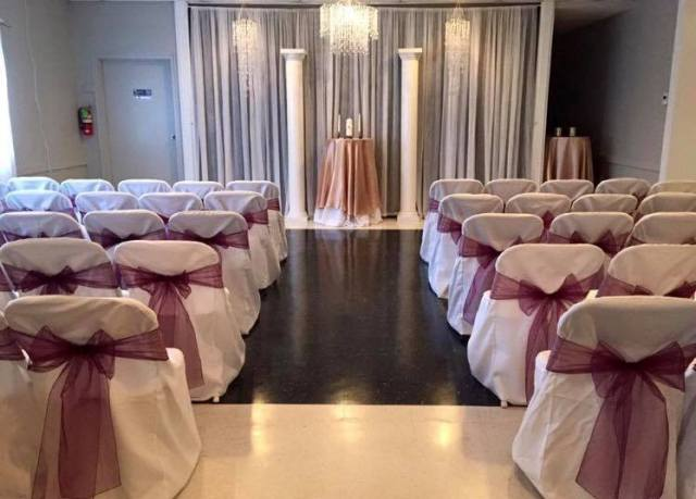 Indoor wedding and reception near Lafayette, Louisiana by Fleur de Lis wedding decorator and wedding planner.