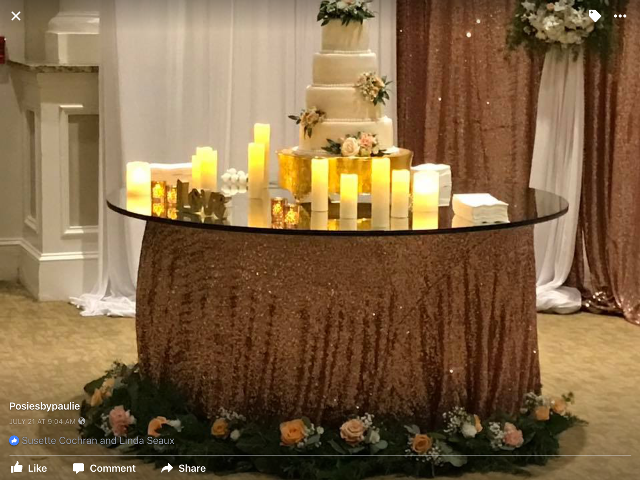 A wedding cake setup by Lafayette, Louisiana florist, Poises by Paulie.