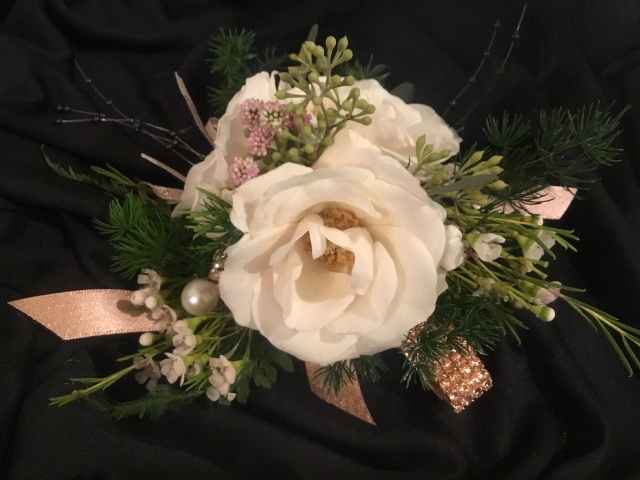 Wedding vendor, Poises by Paulie, a florist located in Lafayette, Louisiana. A beautiful corsage.