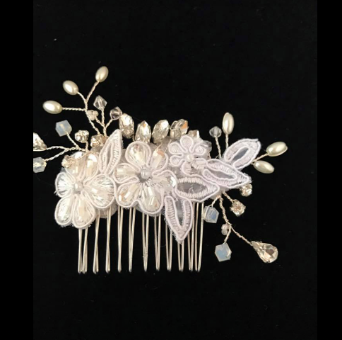 A wedding hair comb made by florist Poises by Paulie, located in Lafayette, Louisiana.