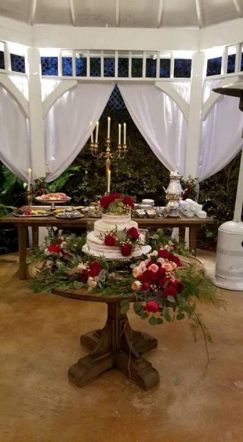 A beautiful wedding cake setup by Louisiana Wedding Venue Near Lafayette The Victorian Plantation in Broussard, Louisiana.
