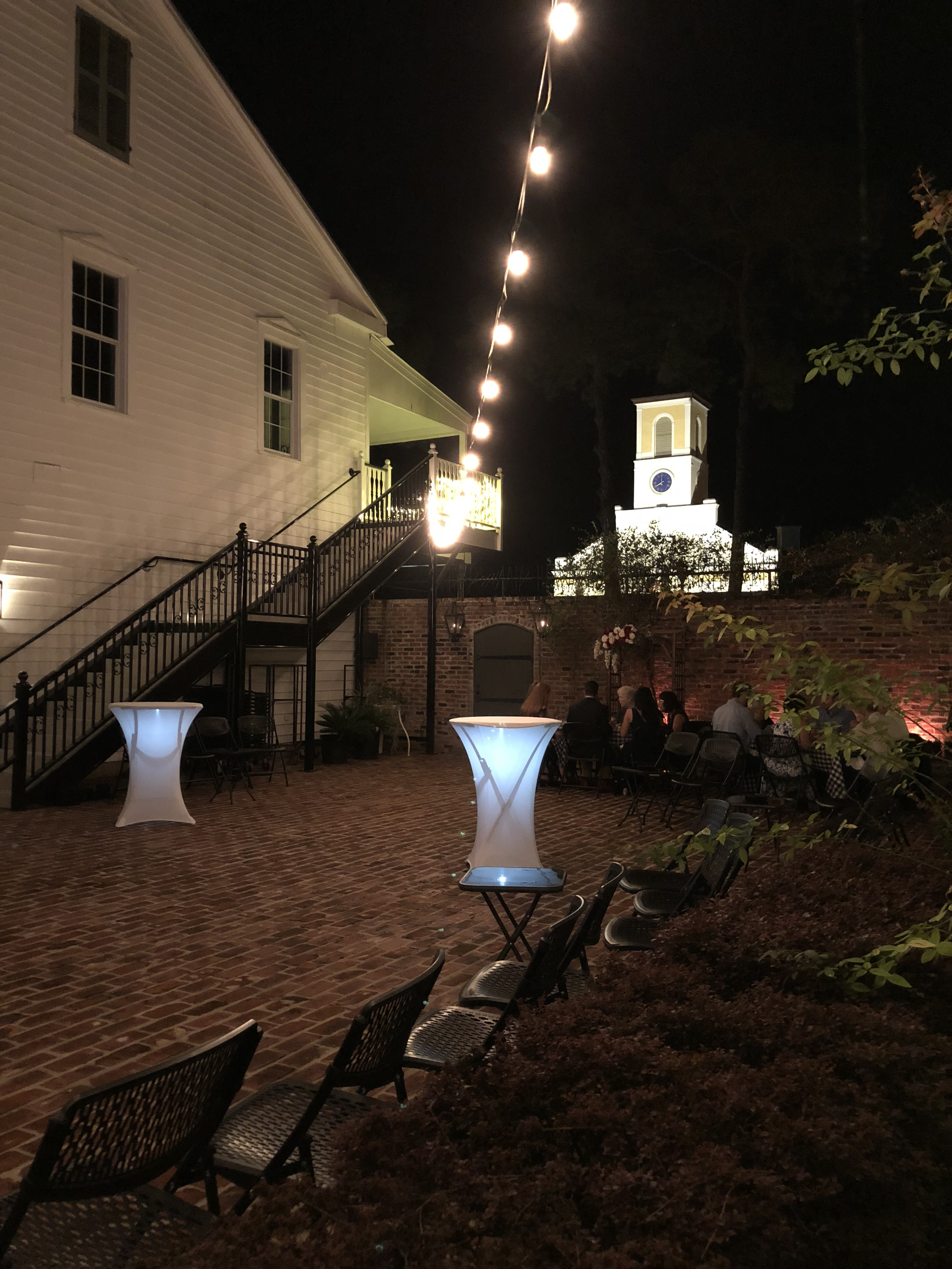 A night view in the courtyard at wedding venue, Maison de Tours, located near Lafayette, Louisiana in St. Martinville.