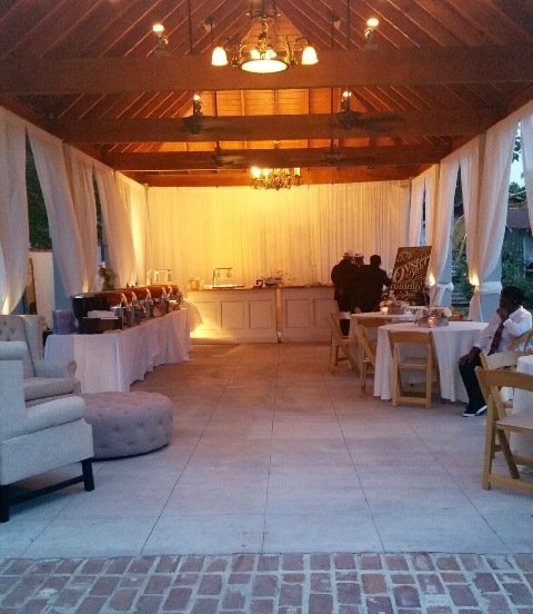 An outdoor reception setup with catering tables in the gazebo at the beautiful wedding venue, Maison de Tours, located near Lafayette, LA.