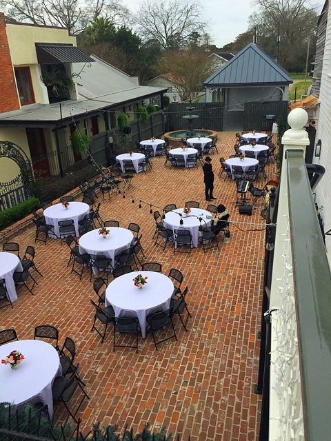 An outdoor wedding reception setup in the courtyard at wedding venue, Maison de Tours, located near Lafayette, Louisiana in St. Martinville.