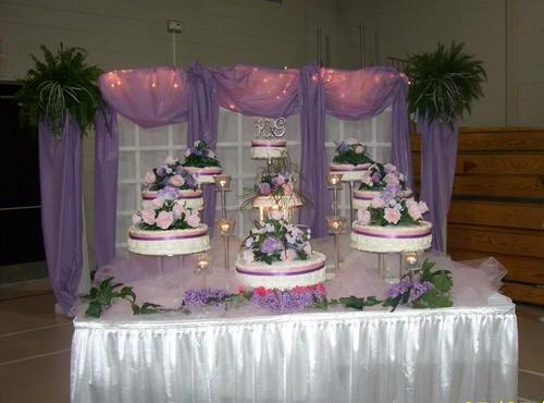 A wedding cake setup by wedding decorator and cake baker, Miss Jo Cakelady, located near Lafayette, Louisiana.
