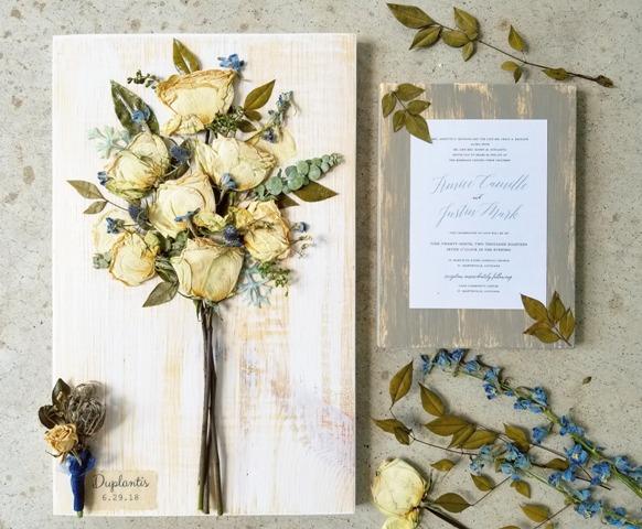 A wedding bridal bouquet and wedding invitation preserved by a wedding vendor located in Lafayette, Louisiana, Petal Press Decor.