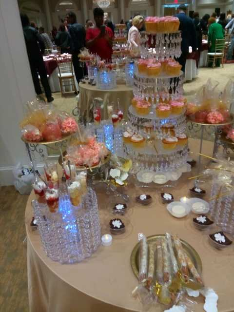 A beautiful wedding sweet treats station by wedding cake baker, Miss Jo Cakelady, located in Lafayette, Louisiana.