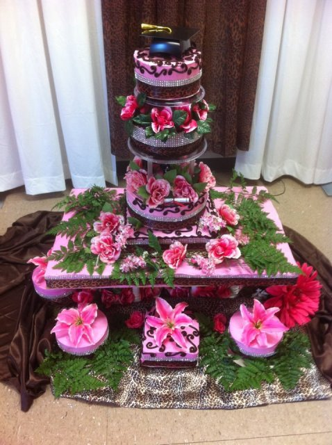 A beautiful pink cake with flowers by wedding cake baker and sweet treat maker, Miss Jo Cakelady, from Lafayette, Louisiana.
