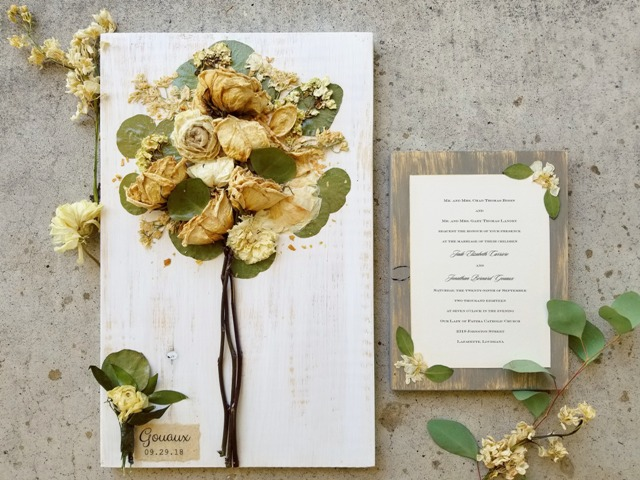 A wedding invitation and bridal bouquet preserved by wedding vendor, Petal Press Decor, located near Lafayette, Louisiana.