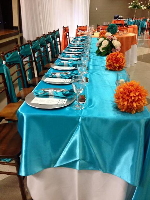 A colorful wedding reception setup by Bridgett Credeur, Fleur de Lis wedding planner and decorator in Lafayette, Louisiana.