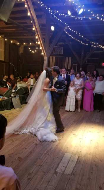 The bride and groom having their first dance at their wedding reception at the Louisiana wedding venue, Feed N Seed, located in Lafayette, Louisiana.