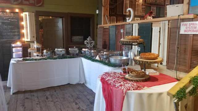 The catering tables set up for a wedding reception at the Louisiana wedding venue, Feed N Seed, located in Lafayette, Louisiana.