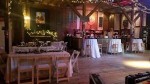 The rustic barn wedding venue located in Louisiana, Feed N Seed, setup for a Cajun wedding reception.