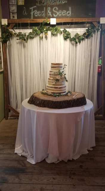 The wedding and event venue, Feed and Seed, located in Louisiana, in Lafayette, set up with the bride and grooms cake.