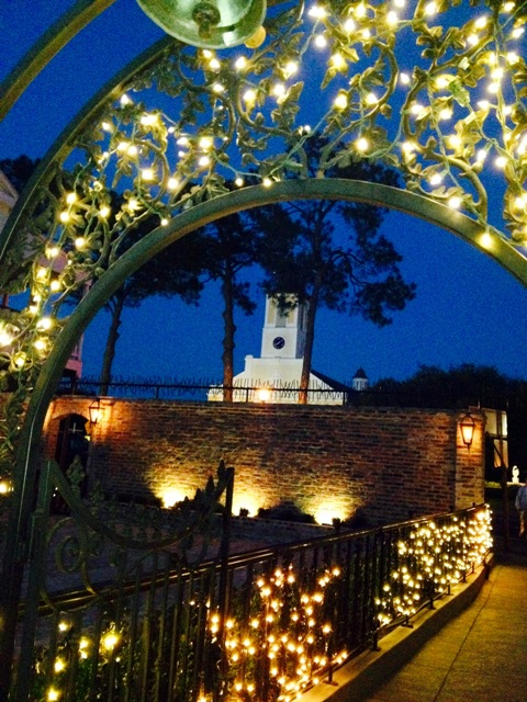 An outdoor night courtyard photo with the church, located in St. Martinville, Louisiana, in the beautiful wedding venue, Maison de Tours, near Lafayette, La.