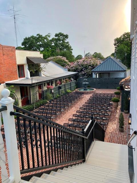 A beautiufl outdoor courtyard wedding setup at the beautiful Louisiana wedding venue, Maison de Tours, located near Lafayette, LA in St. Martinville, LA.