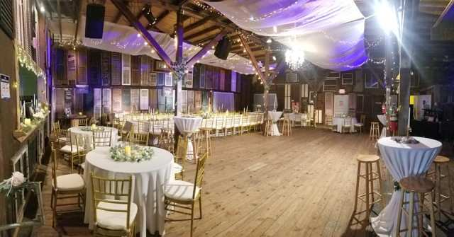 A wedding reception hall and event venue, Feed N Seed, located in Louisiana in Lafayette, setup for a beautiful wedding reception.