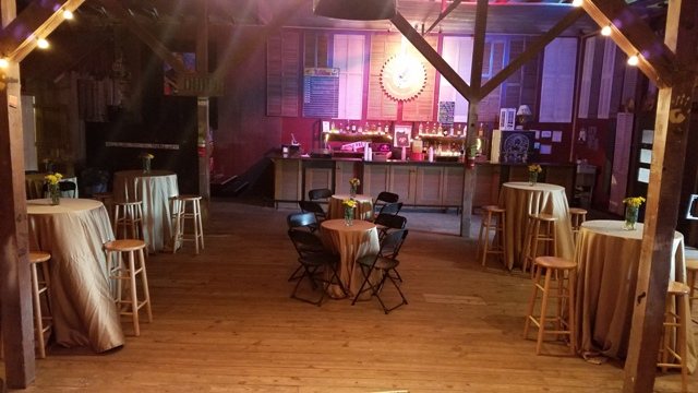A rustic barn wedding venue in Louisiana, Feed and Seed, tables set up for a wedding reception in Lafayette, LA.