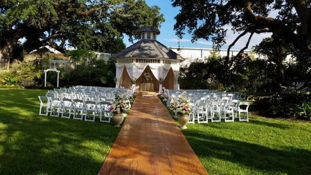 A beautiful outdoor wedding setup at the historic wedding venue, The Victorian Plantation, located near Lafayette, Louisiana.