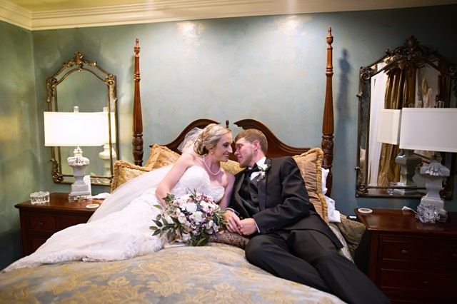 A bride and groom in the Bridal Suite at the wedding venue, Louisiana Cajun Mansions, located near Lafayette, Louisiana.