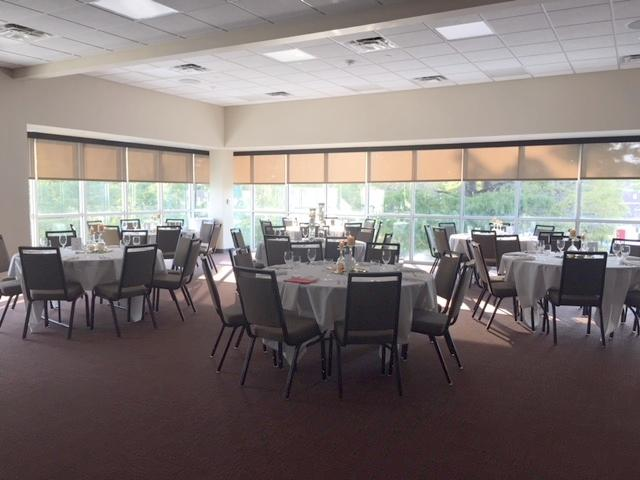 An indoor event setup with tables and linens at UL Lafayette Event Spaces in Louisiana.