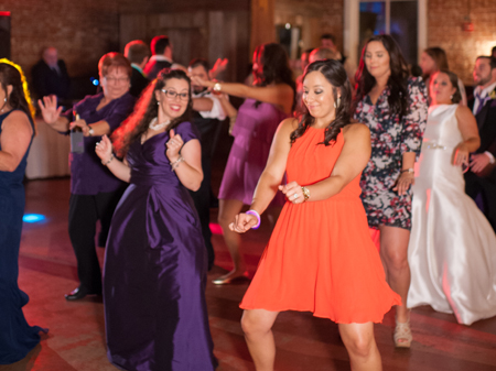 A photo of a wedding reception with dancers at a wedding venue near Lafayette, Louisiana, with music by DJ, Mike Schnauder, with Digital Music Services.