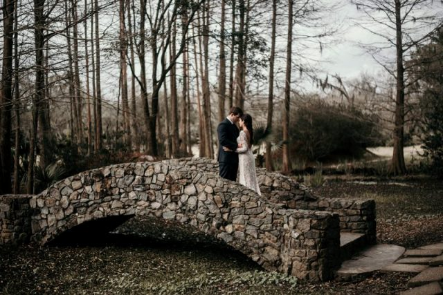 A bride and groom photo on a bridge by wedding photographer, DK Hebert Photography, located near Lafayette, LA.
