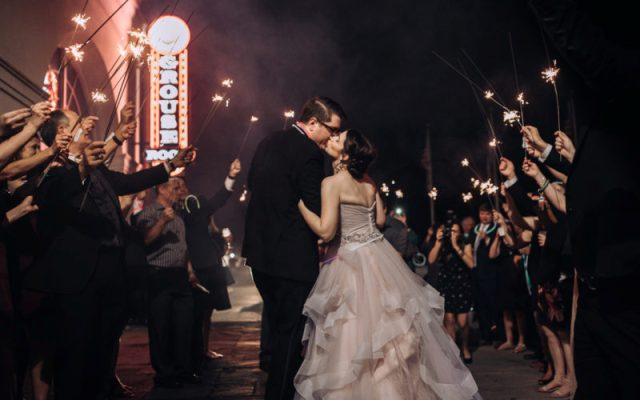 The bride and groom leaving their reception with sparklers by wedding photographer, DK Hebert Photography, located near Lafayette, LA.
