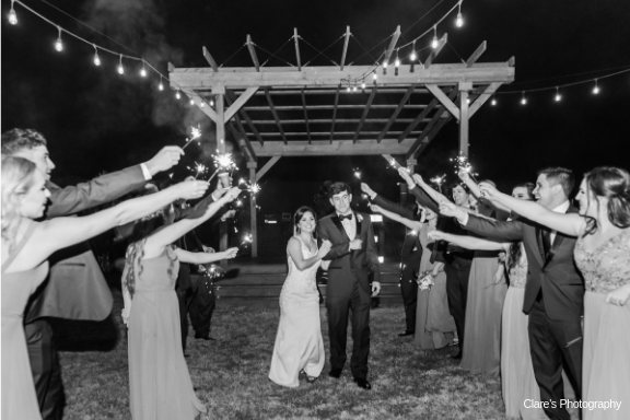 A bride and groom leaving with sparklers at the wedding venue, Warehouse 535, located in Lafayette, Louisiana.