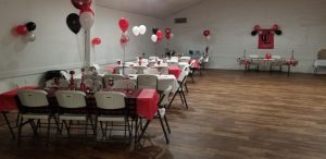 Tables and chairs set up for a graduation event held at The Hall, a wedding venue located near Lafayette, Louisiana.