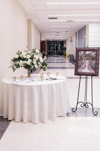 A sign in table setup for a wedding reception at UL Lafayette, a wedding venue located in Lafayette, LA.