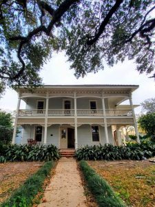 A front view of a wedding event venue, The John Nickerson House Event Center, in Lafayette, Louisiana.